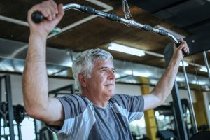 elderly man weight training in North Finchley